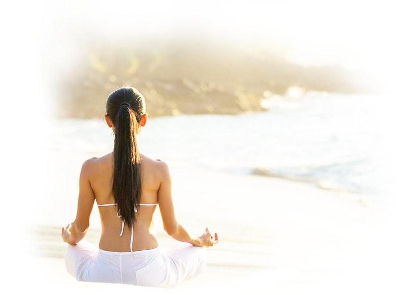 woman meditating on te beach Helenika Travels retreats