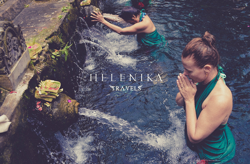 Helenika Travels water blessing at the water temple bali
