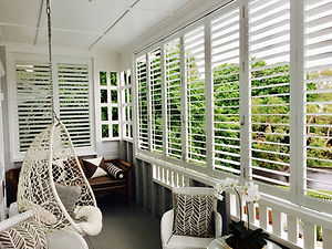 outdoor shutters white bifold closed 1.j