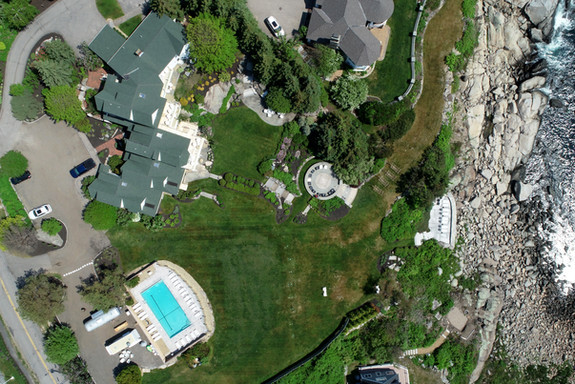 Aerial View of The ViewPoint Hotel in York, Maine Featuring an Outdoor Pool, Expansive Lawns, Three Patios, and Views of Nubble Lighthouse