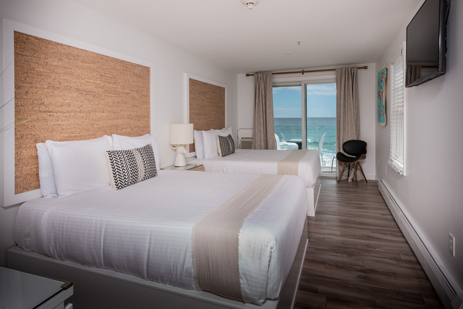 Stones Throw Beachfront Hotel and Restaurant | Main Building Hotel Room