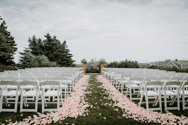 Outdoor wedding ceremony aisle at The ViewPoint Hotel in York, Maine. Rose petal wedding aisle