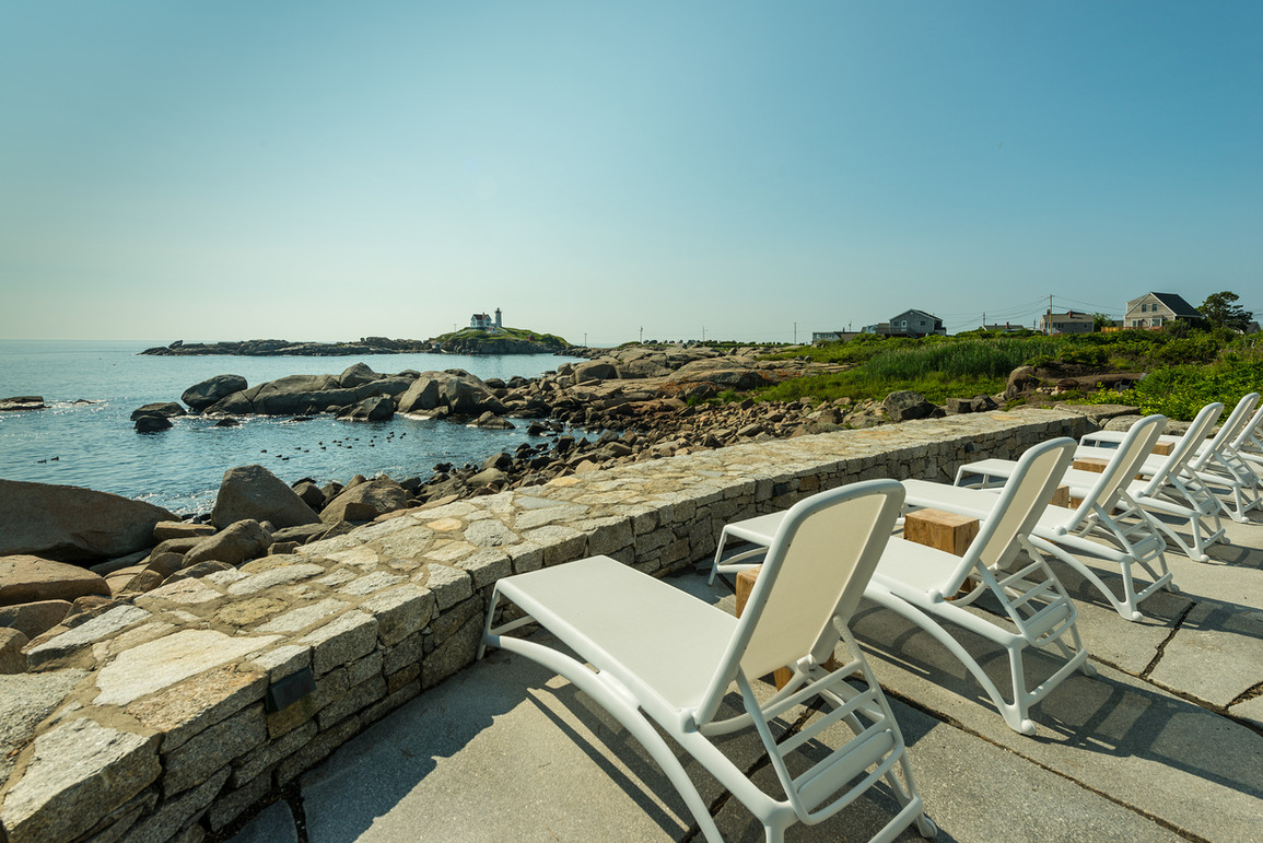 Maine Waterfront Hotel | Nubble Lighthouse Oceanside Patio View | York, Beach