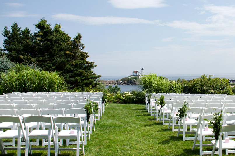 Ceremony aisle with Nubble Lighthouse backdrop in York, Maine