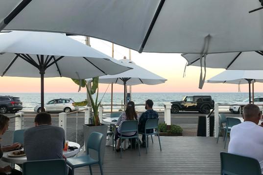 Enjoy Sunset overlooking Long Sands Beach at Stones Throw Restaurant