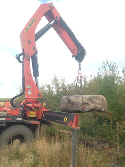 Lifting large rock for client