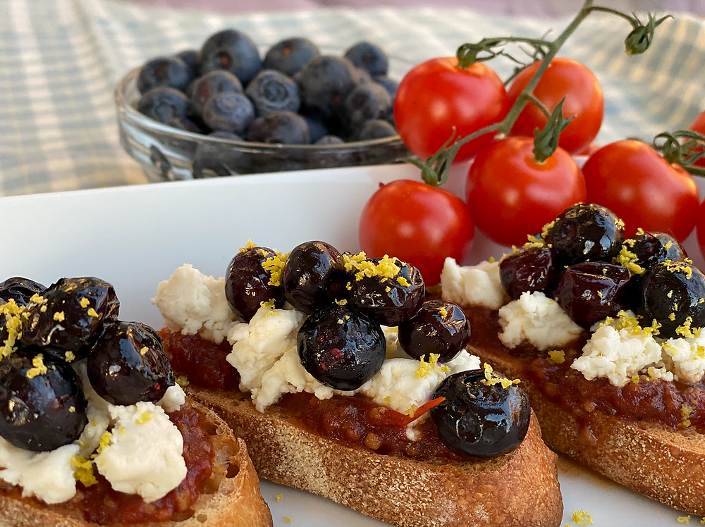 Goat cheese crostini with roasted blueberries and tomato jam