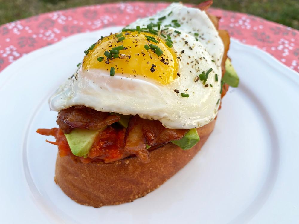 Avocado, bacon and egg toast with tomato jam