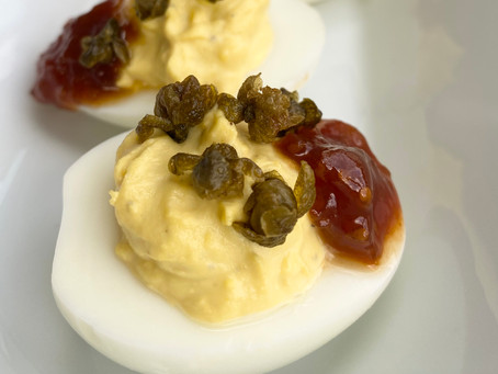 DEVILED EGGS WITH TOMATO JAM AND FRIED CAPERS
