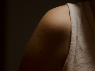 How can massage help with a frozen shoulder?