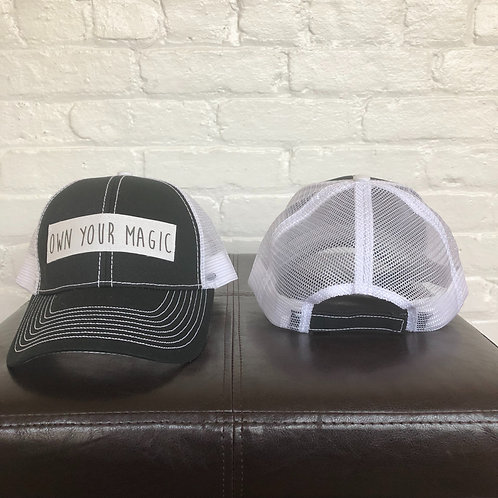 """""""Own Your Magic"""" Black and White Trucker Hat"""