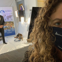 Our Vice President of Operations, Elise Becker, wearing our official MLI face mask, helping backstage with Perry Baltimore.