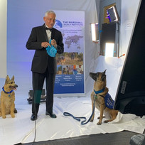 Sammy, our Canine Ambassador, getting treats before coming on air.