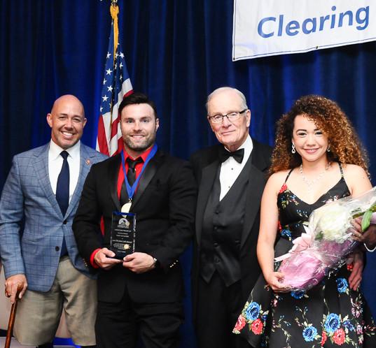 Survivors' Award recipient JP Lane with Congressman Mast, LTG Rhame, and his wife, Crystal Lane