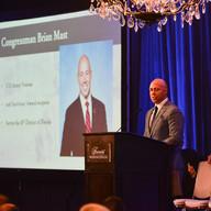 Congressman Brian Mast presents award to Specialist (Ret.) JP Lane