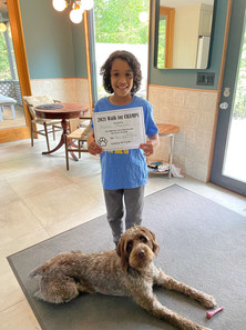 North Mianus student and furry friend after participating in the Paw-er Walk for Peace!
