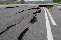 Road collapses with huge cracks. Interna