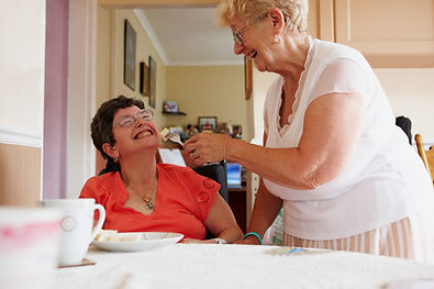 carer_helping_woman_eat.jpg