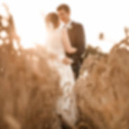 Bride and groom in wheat field