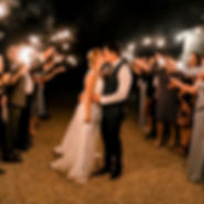 Bride and groom kissing with sparklers
