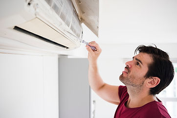 male-electrician-checking-air-conditione