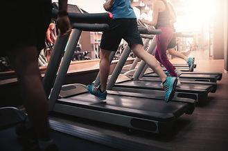 People running in machine treadmill at fitness gym club.jpg