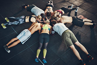 Fit young people focused on planking in
