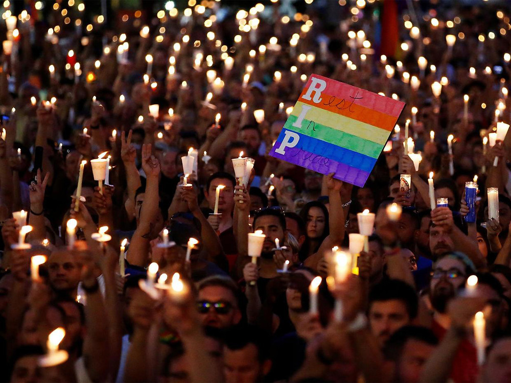 People take part in a candlelight memorial service the day after a mass shooting at the Pulse gay nightclub in Orlando | Reuters