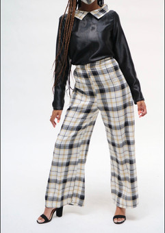 black top with a plaid collar, aired with plaid pants
