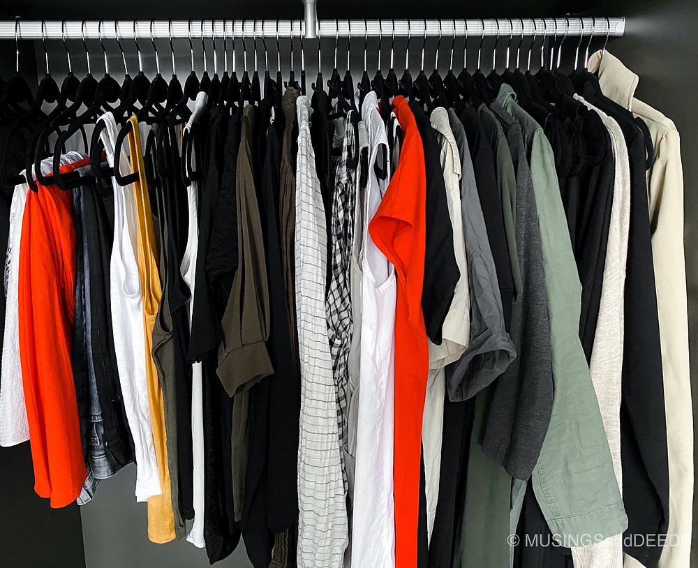 Clothes in hangers in closet