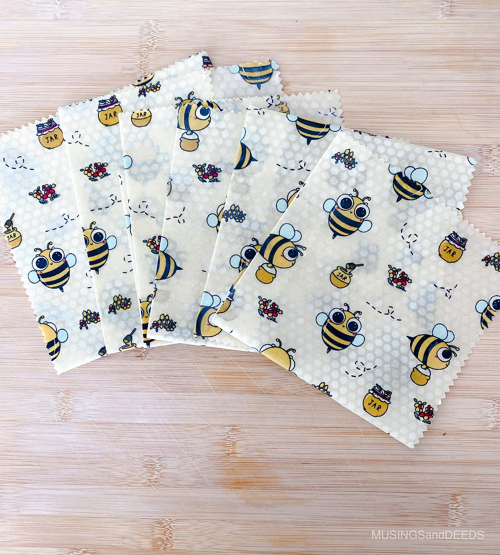 Different sized beeswax wraps on top of bamboo board