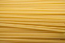 Yellow long spaghetti on black backgroun