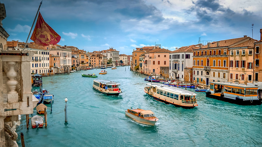 Water taxi and vaporetto boats traverse
