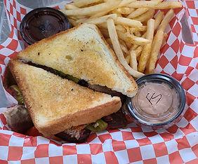 chuckwagon brisket sandwich.jpeg