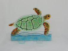 turtle on glass stand