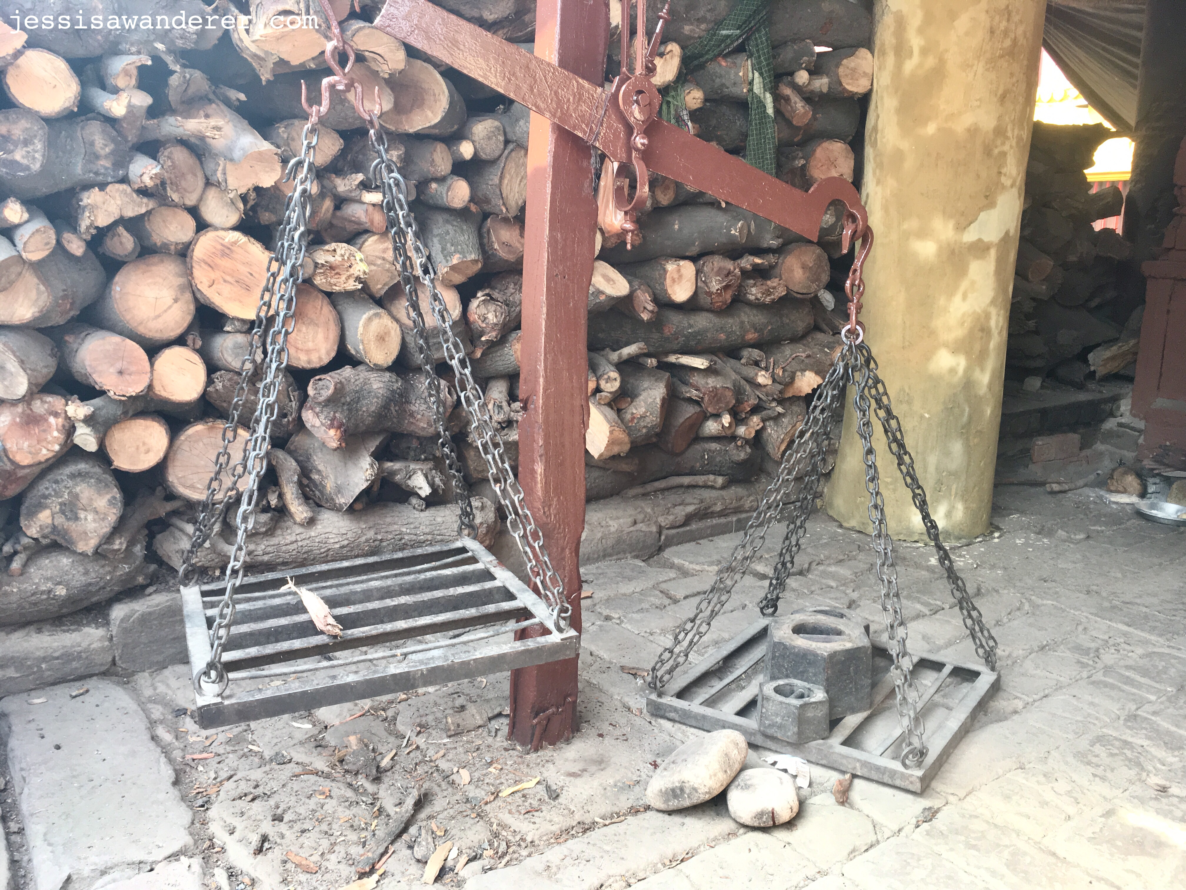 Weighing wood for burning ceremony
