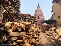 Wood pile and Temple in Varanasi