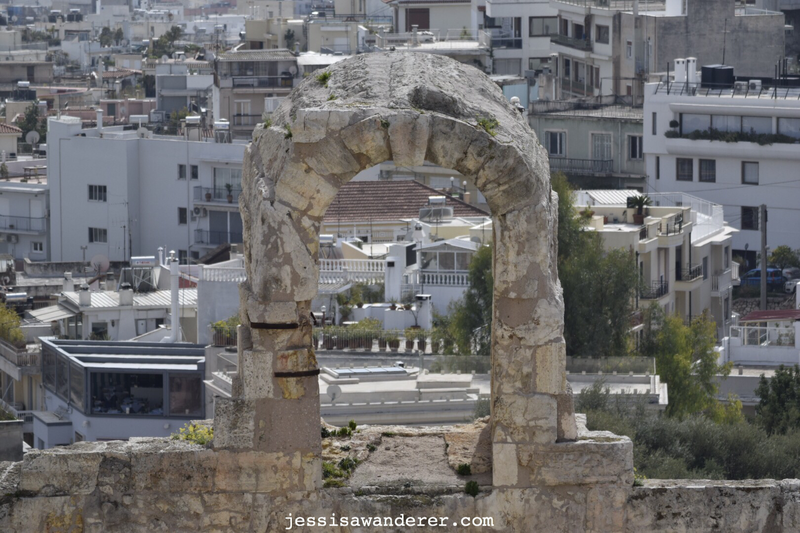 Ancient Arches and Modern Buildings
