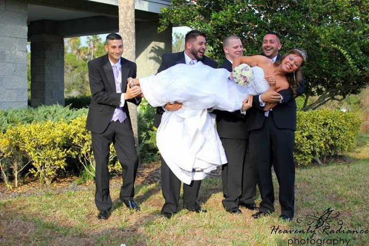 Groomsmen Hold The Bride