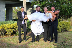 Groomsmen Hold The Bride
