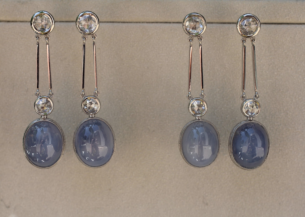 Two pairs of bespoke platinum star sapphire and rose-cut diamond earrings