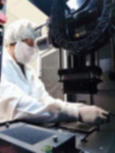 StemoniX scientist testing high-throughput plate