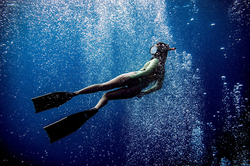 A person swimming through bubbles underwater_edited.jpg