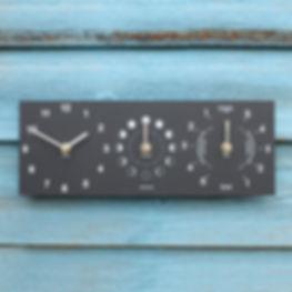 ashortwalk tide clock on a blue wooden w