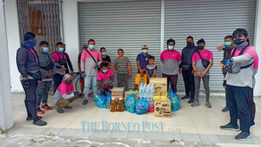 Families staying at Senadin shophouse get aid after 'white flag' photo goes viral