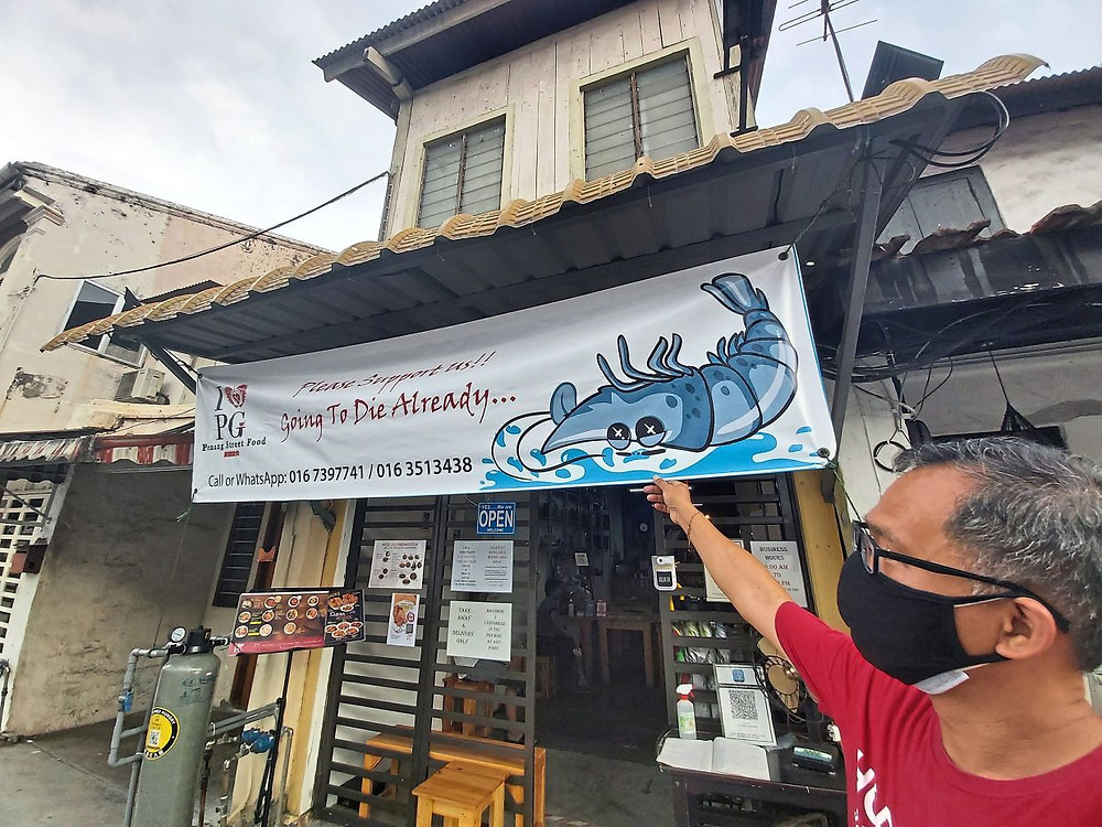 Ingenious marketing: The Penang-inspired restaurant at Jalan Tengkera in Melaka became an instant hit after unfurling the 'Going To Die Already' banner.