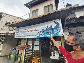 'Going to die' banner by eatery outlet owner pays off