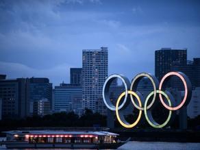 Japan PM warns of closed-door Olympics as virus cases rise