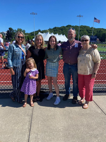 Laura and family at Addison's Middle School Graduation