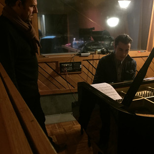 Producer Nigel Martinez with Isaac Wilson at the piano